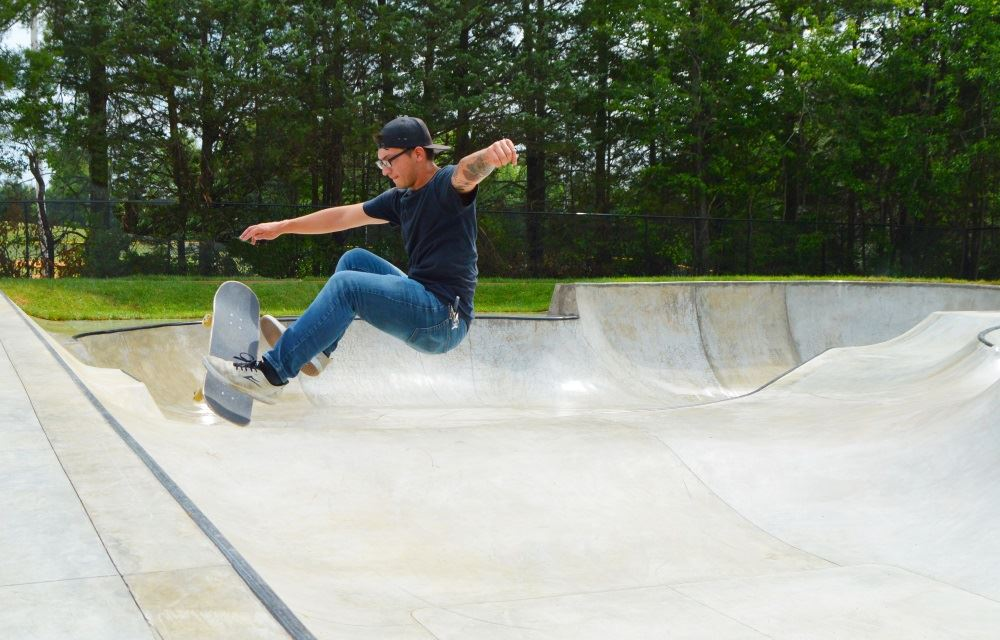 A skateboarder rides the wall at Park View Skate Park.