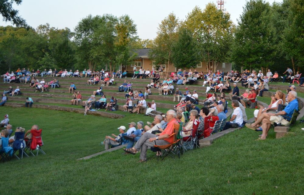 Concertgoers gather at Dogwood Park.