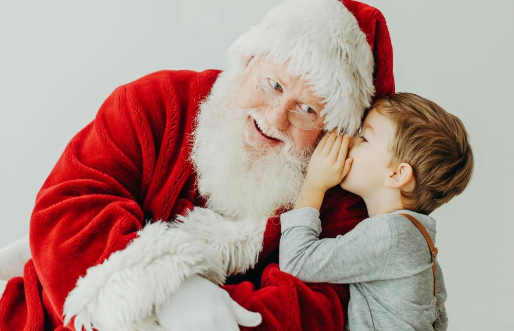 A child shares his Christmas wishes with Santa