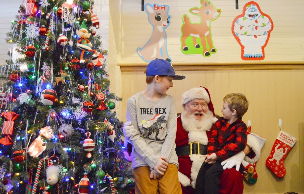 Children talk with Santa during Depot Christmas Open House