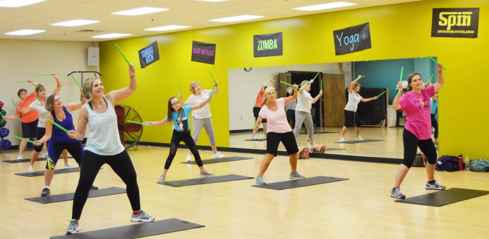 People participate in a group fitness class.